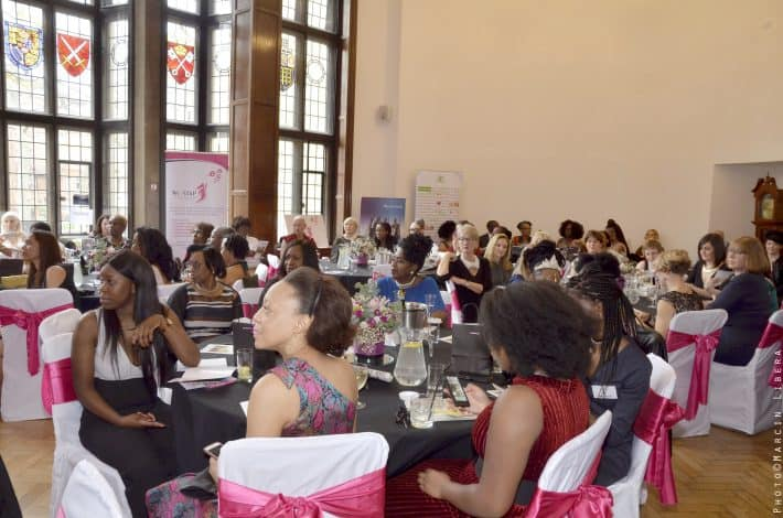 audience sitting at tables and listening at Amazing Women Global awards event