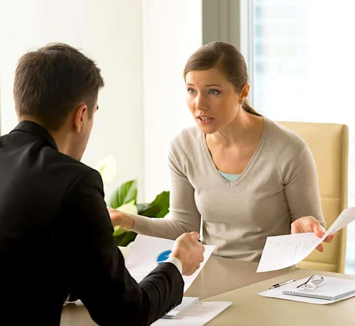 Homeowner Negotiating With Insurance Claims Adjuster