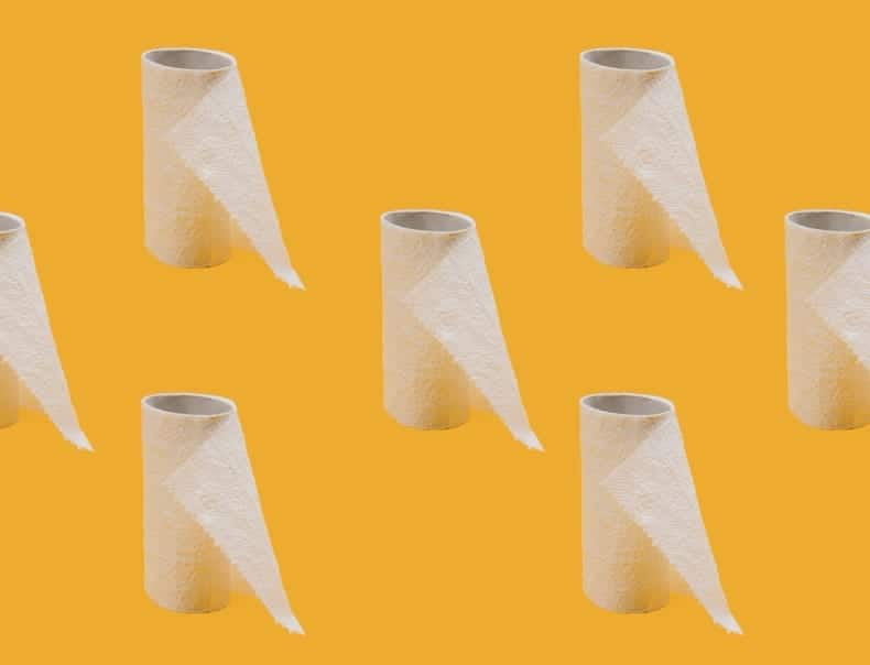yellow background with rows of nearly-empty toilet paper rolls.