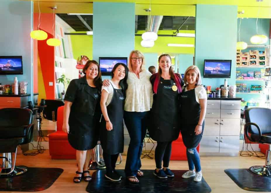 Pigtails & Crewcuts franchise owner Kendra Keating with her staff in her salon