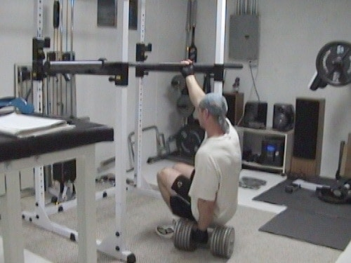 One Arm Gripping Dumbell Squats for Thighs and Glutes