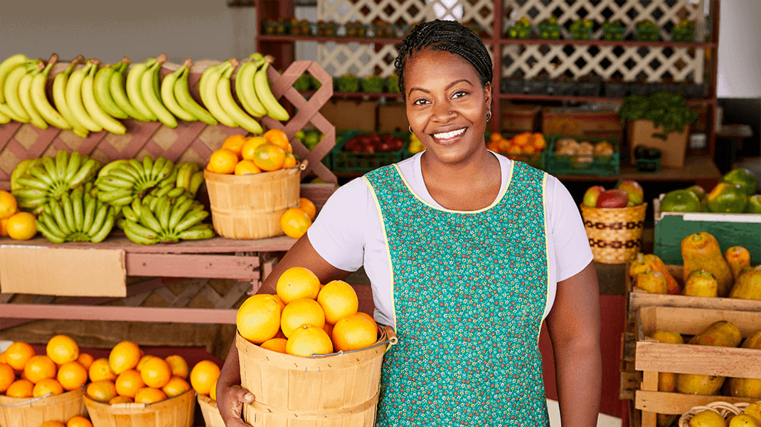 Woman Carrying A Basket Of Oranges - Branding Agency - Citizen Best