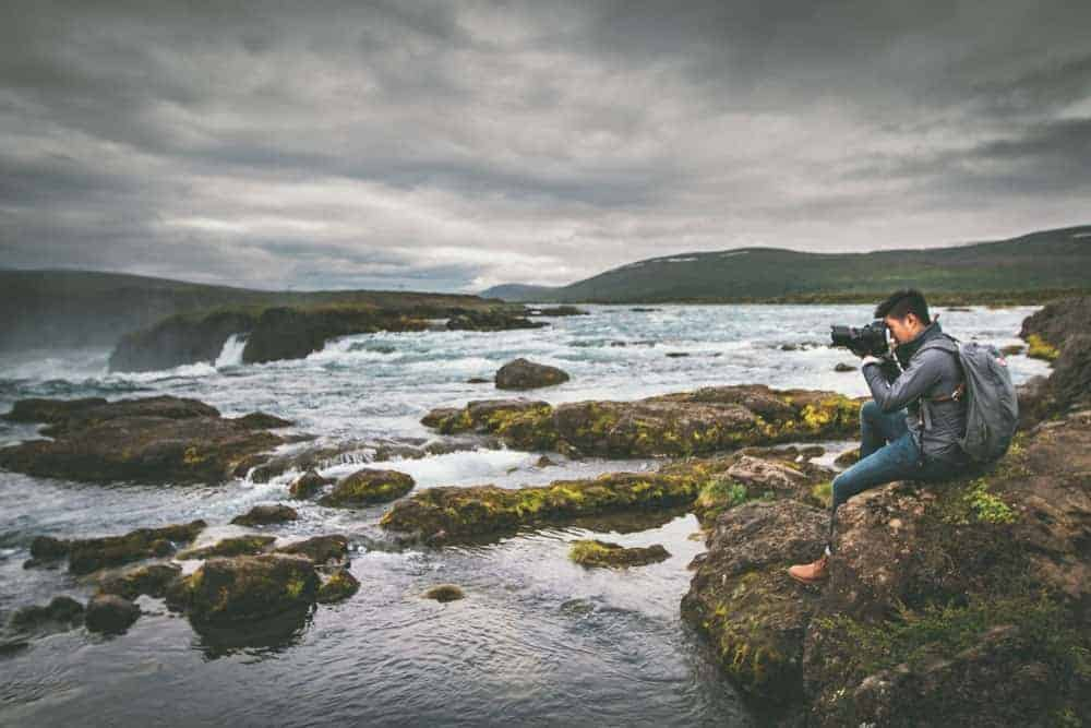 photographer taking photos in stormy weather conditions