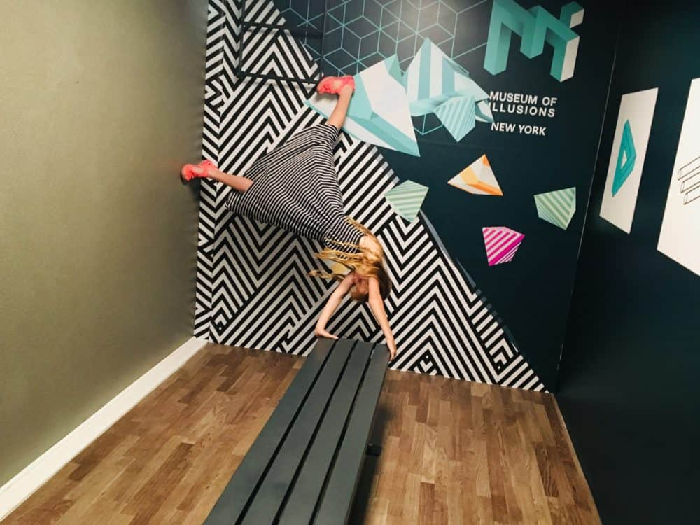 Doing a handstand at the museum of illusions