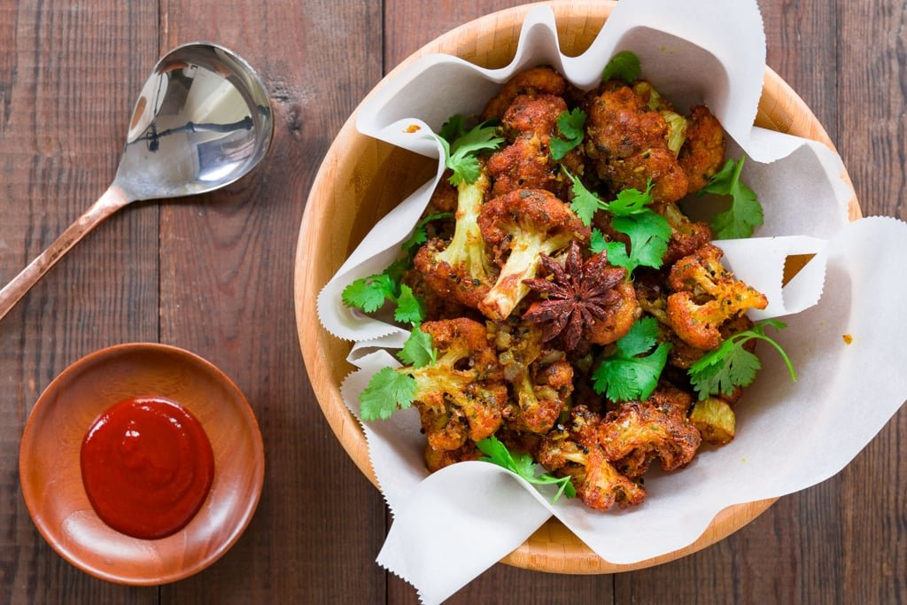 Gobi 65 is a delicious appetizer with crispy fried cauliflower tossed with tempered spices, garlic and ginger.