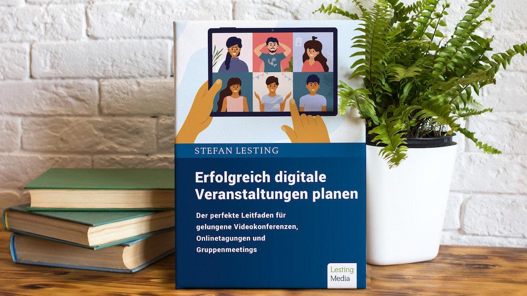 Buch digitale Veranstaltung auf Schreibtisch