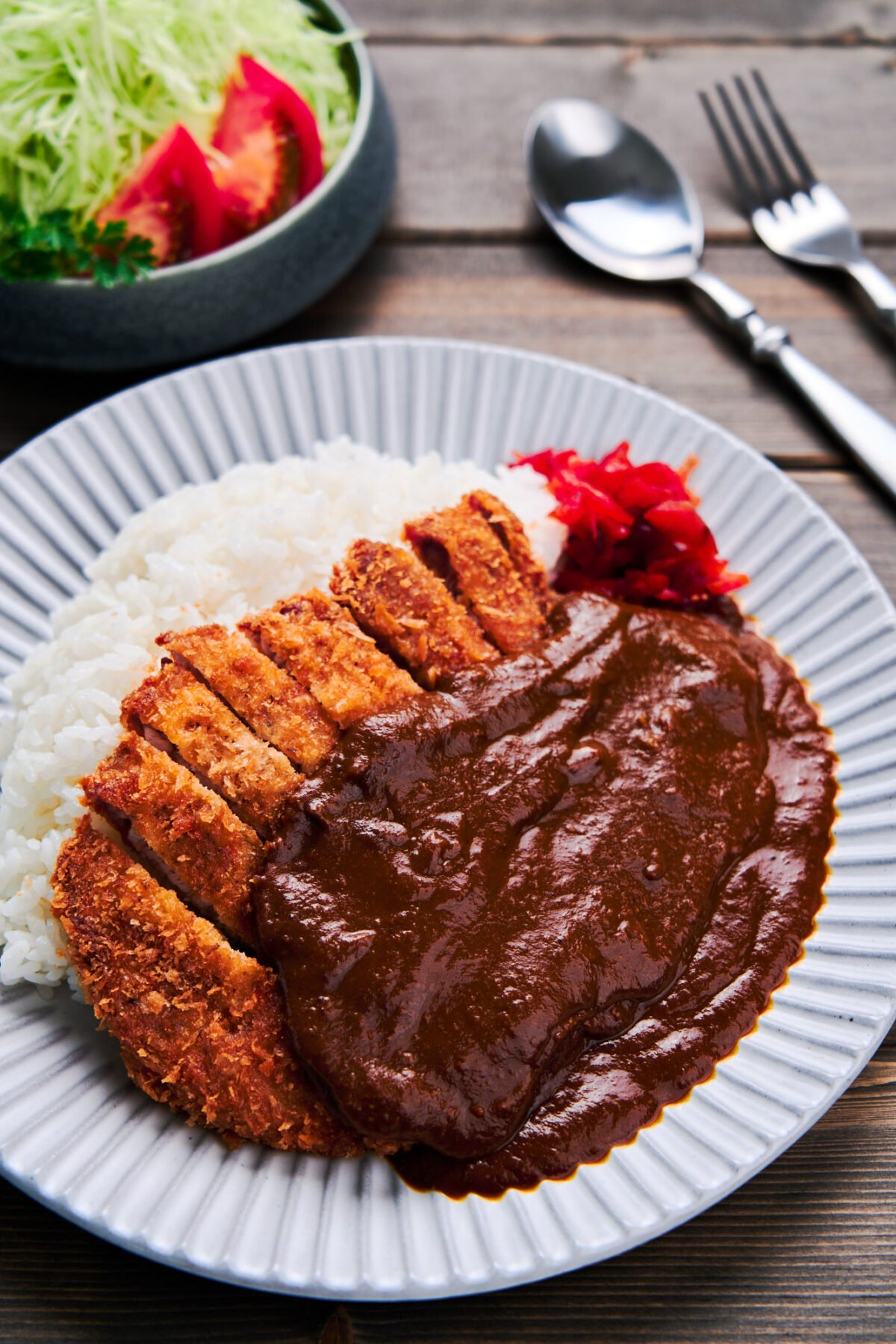 With a crispy pork cutlet draped in a luscious blanket of Japanese curry, this Katsu Curry recipe comes together in under 30 minutes.