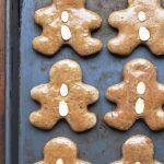 Lebkuchen Gingerbread Men with almond buttons on baking sheet
