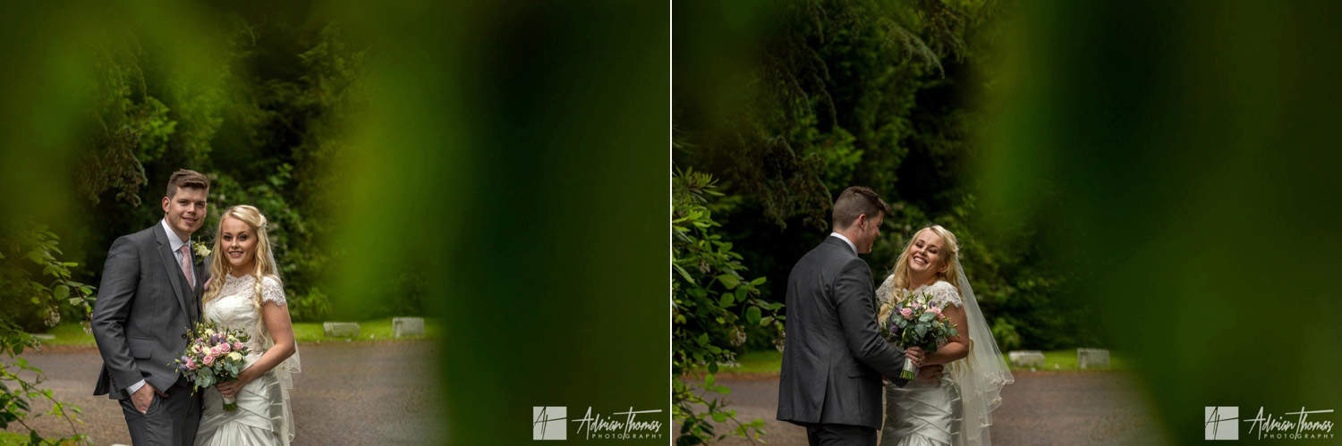 Bride and groom laughing with each other at Maes Manor Hotel wedding reception.