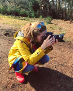An image of the wedding photographer Harriet Bird taking a perfect shot for a bride and groom