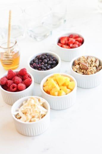 Ramekins filled with yogurt toppings