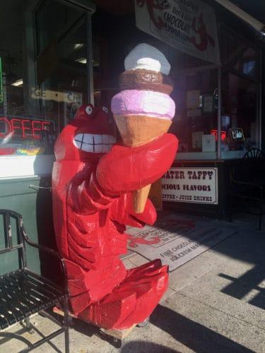 A lobster enjoys an ice cream cone in bar harbor