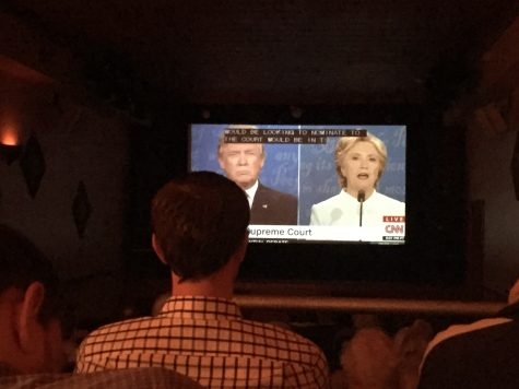 Residents watch as the nominees debate for the third and final time before the election.