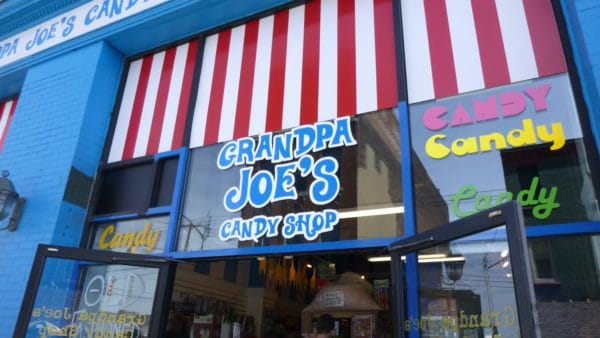 The hard to miss facade of grandpa joe;s candy shop on the strip