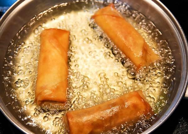 Frying Spring Rolls in Pan