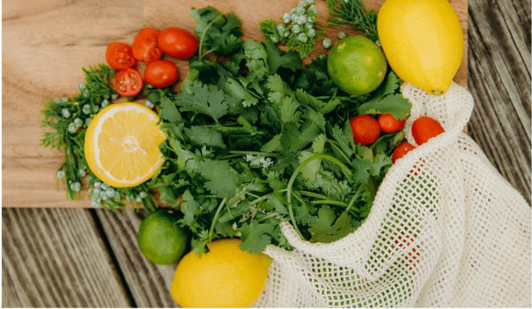 fresh produce inside a mesh canvas produce bag