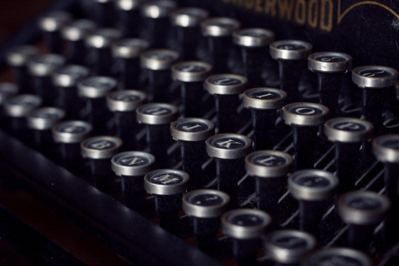 A close-up of typewriter keys.