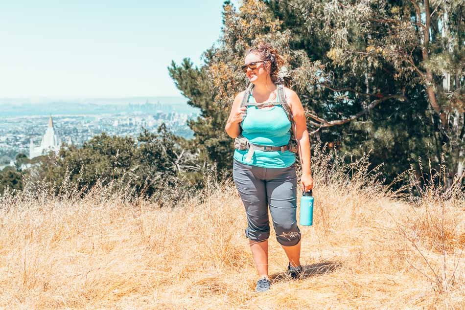 Lia in the prAna Halle pant hiking and wearing a backpack.