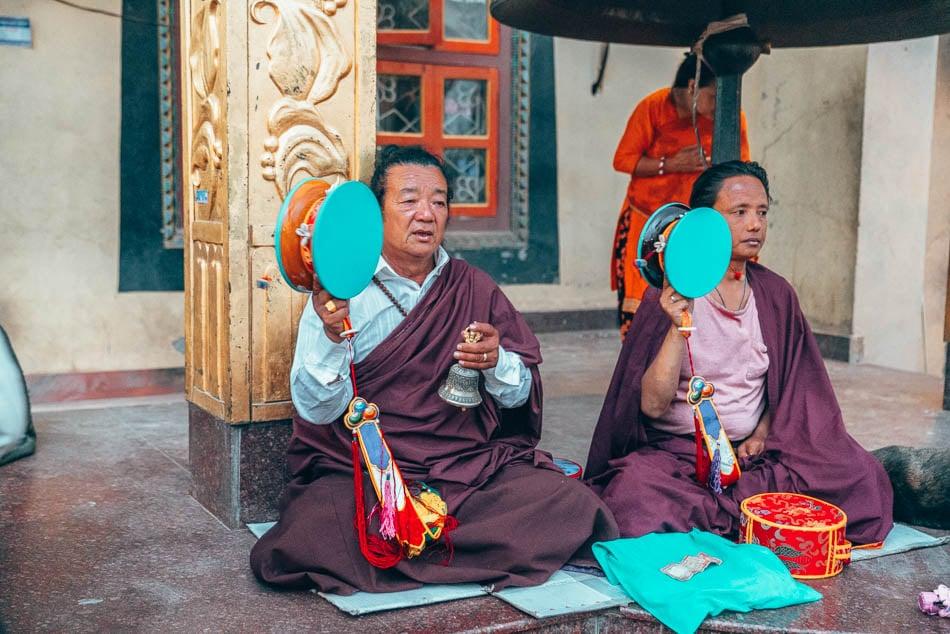 Monks chanting outside of a monestary at the Boudhanath Stupa in Kathmandu, Nepal