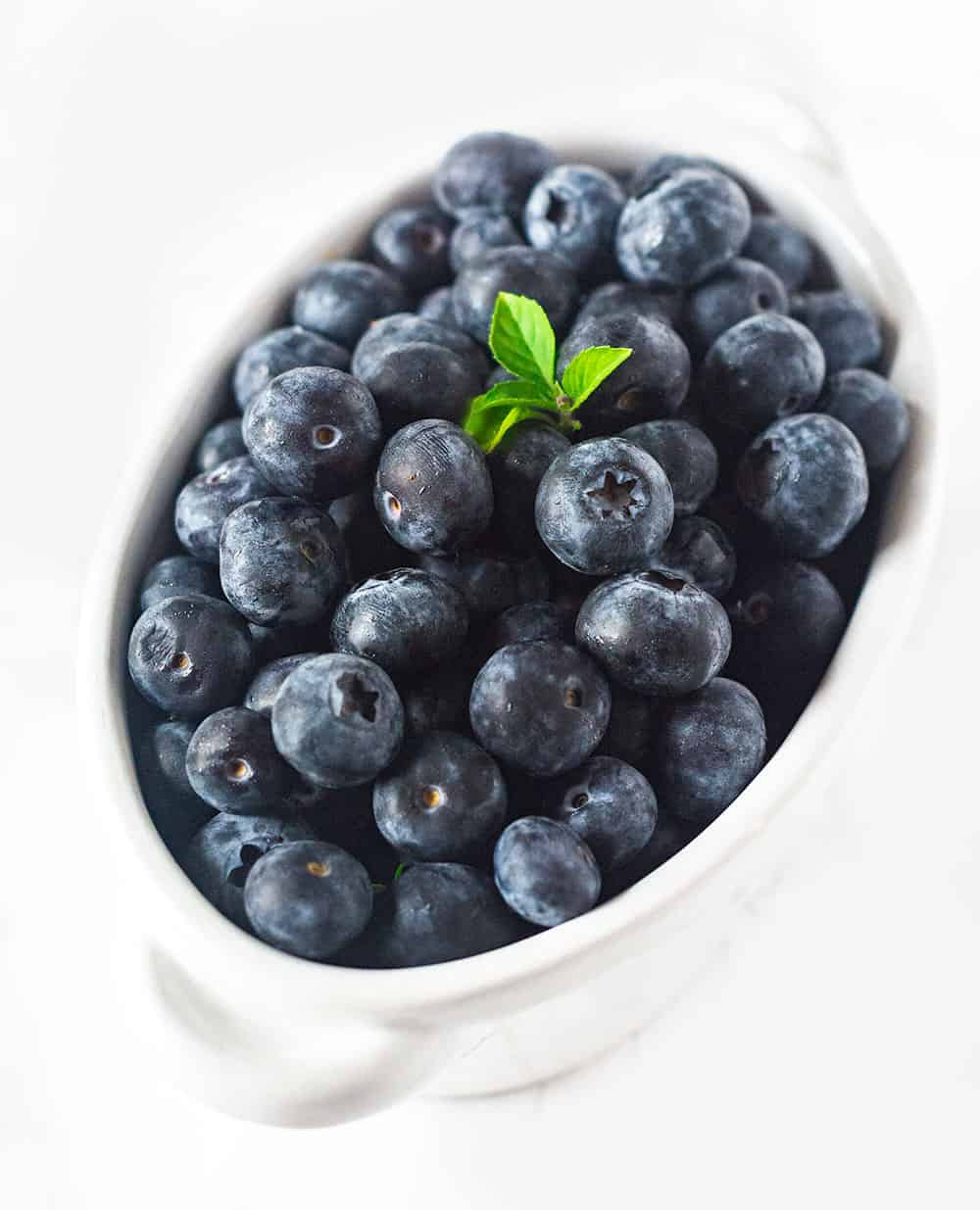 Blueberries For Blueberry Banana Smoothie in a white bowl
