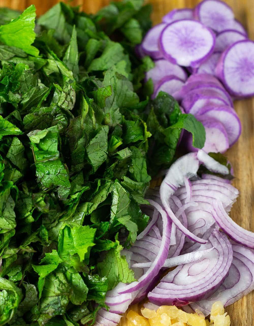 Chopped green radish leaves, purple radish slice