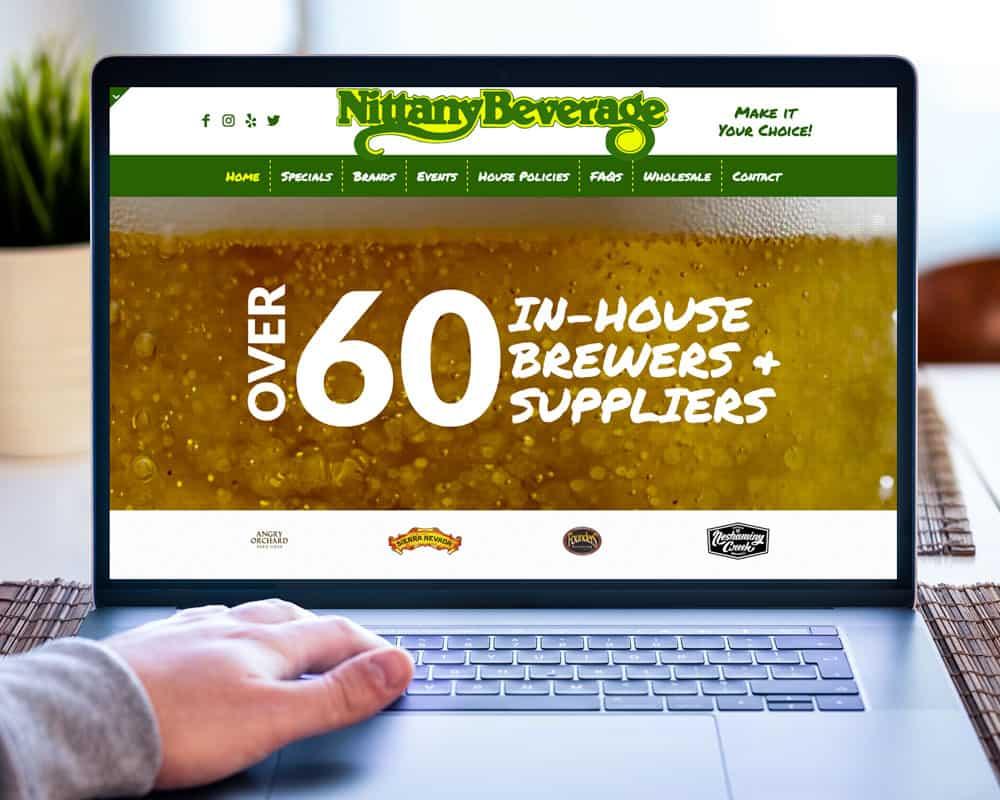 Nittany Beverage website displayed on a laptop