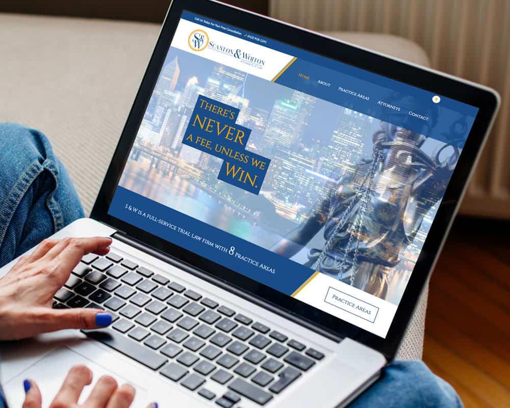 Scanlon & Wojton Attorneys Website displayed on a laptop