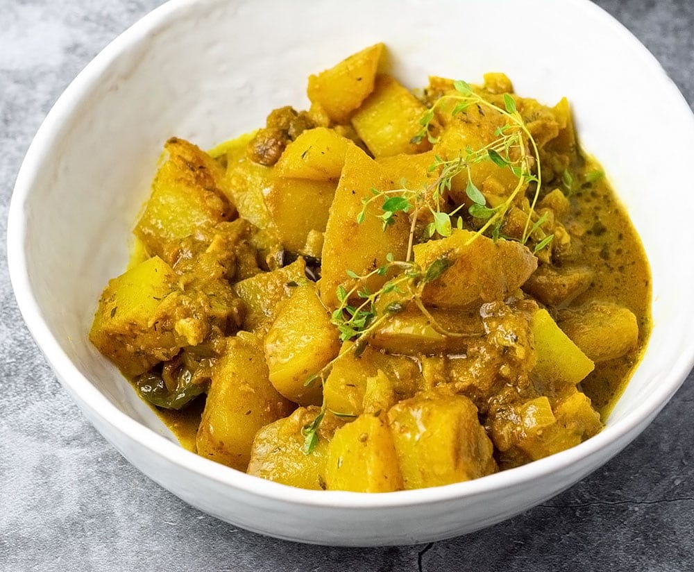 vegan jamaican chayote curry in a white bowl