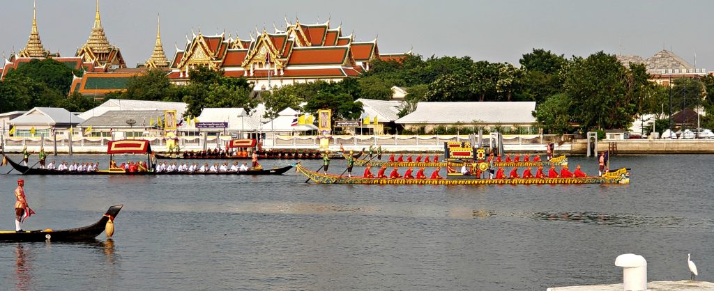 5 long boats cruise the Chao Phraya River for the Thai Royal Barge Processional