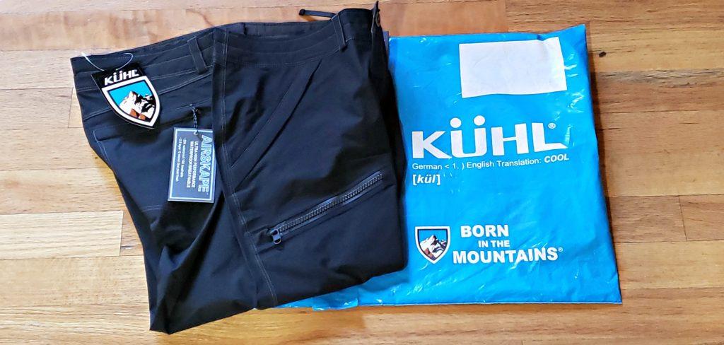 Folded KÜHL JetStream™ Rain Pants with tags and plastic shipping bag