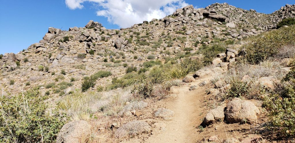Dry trail leads through granite boulders on the Hotshots Trail