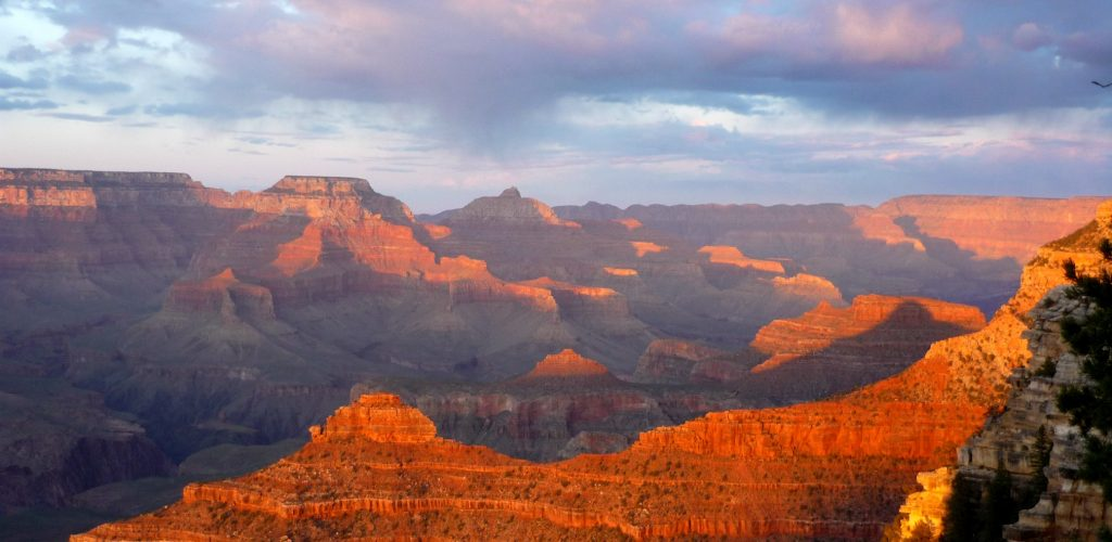 looking into the Grand Canyon from a South Rim viewpoint at sunset