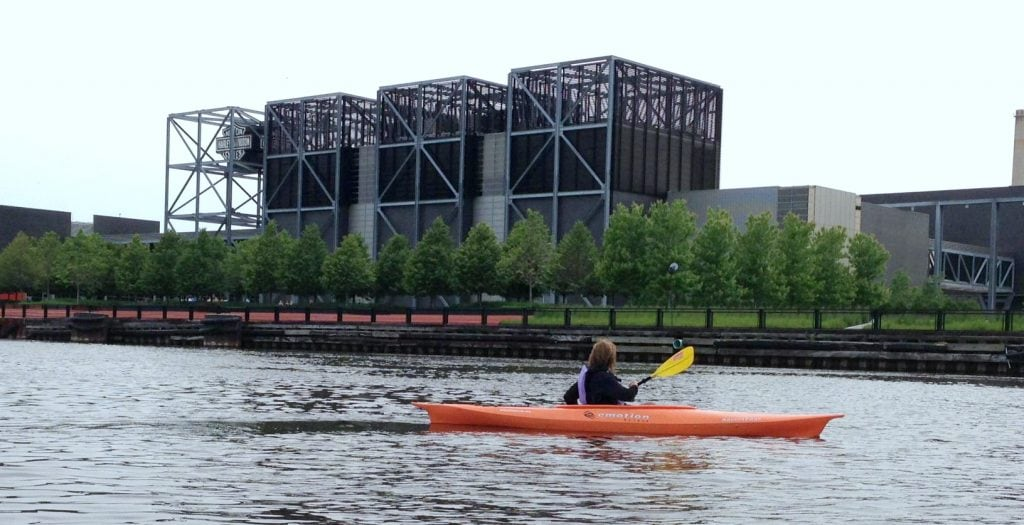 UNSTOPPABLE Stacey paddles by Harley-Davidson Museum on one of the kayak tours in Milwaukee.