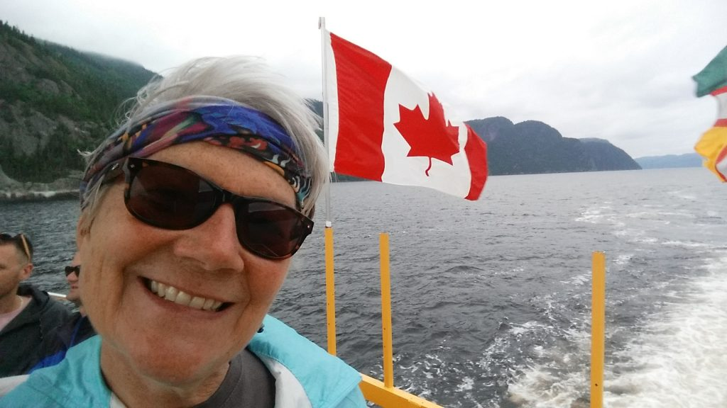 arizona travel writer stacey wittig in Les Navettes maritimes du Fjord, marine shuttle with CAnadian flag behind