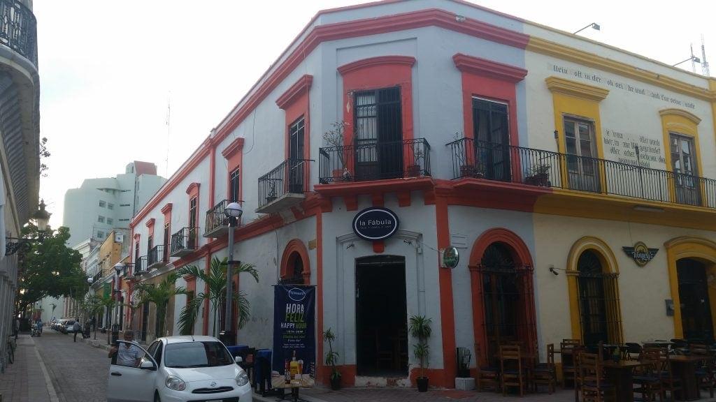 Two story historic Mazatlan building with wrought iron embellishments on balcony