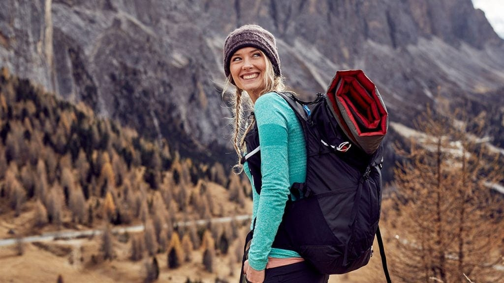 young woman backpacking in mountains