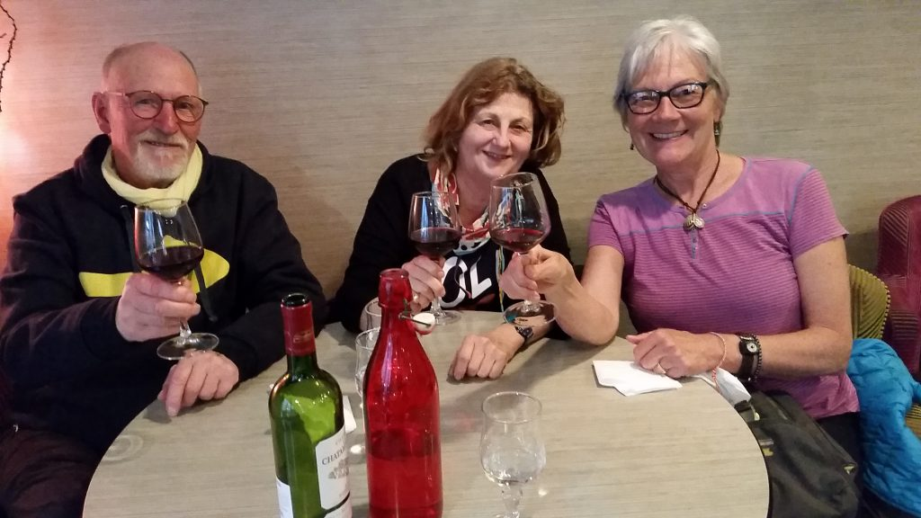 Author Unstoppable Stacey sits with two friends at affordable Bordeaux restaurant during visit Bordeaux France