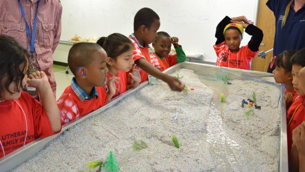 Children using an Emriver Em2 Stream Table