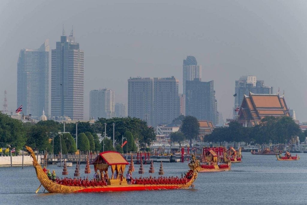 Gilded long boat with 60 oarsmen paddle on the river for part of the Thai Royal Barge Processional