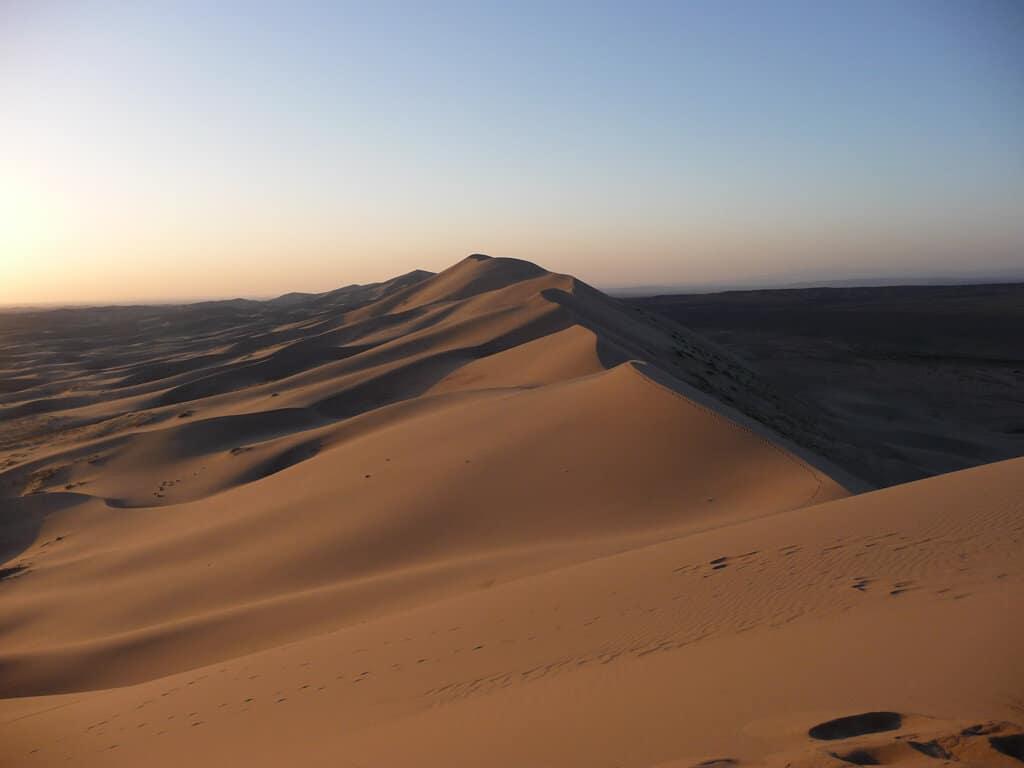 Climbing The Sand Dunes In The Gobi Desert Mongolia