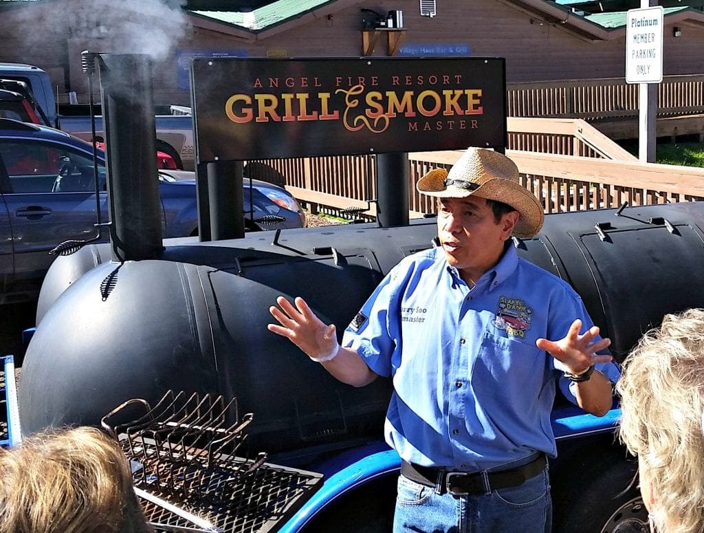 Celebrity Chef Harry Soo stands in front of BBQ grill at Angel Fire Food and Wine Roundup