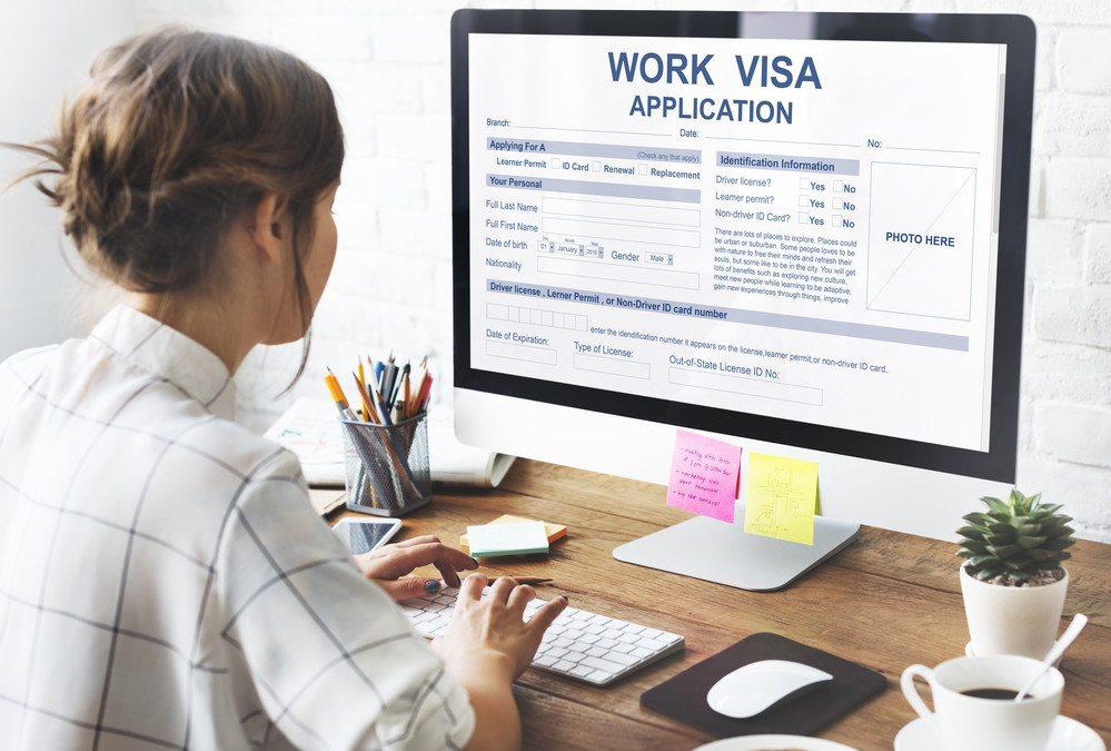 Girl Looking at Neelam Bhardwaj Immigration site regarding Trumps H1-B Visa Program Changes