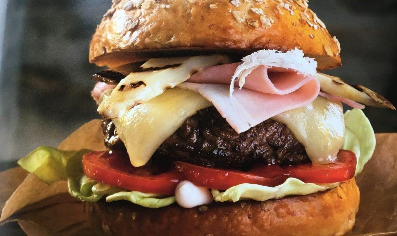 A close up of a burger