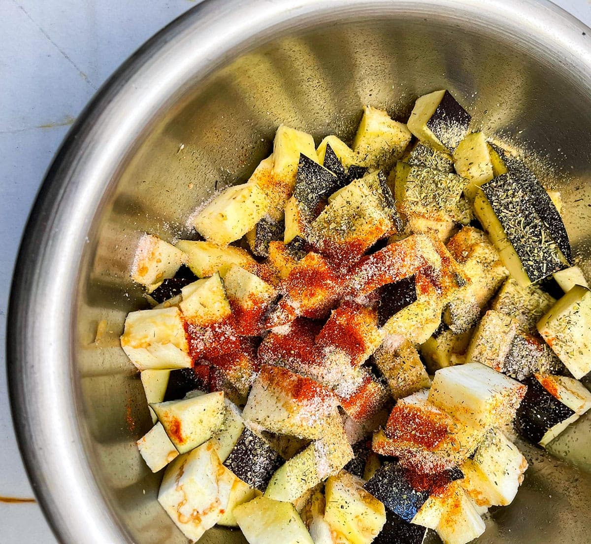 seasoned eggplant cubes in a bowl
