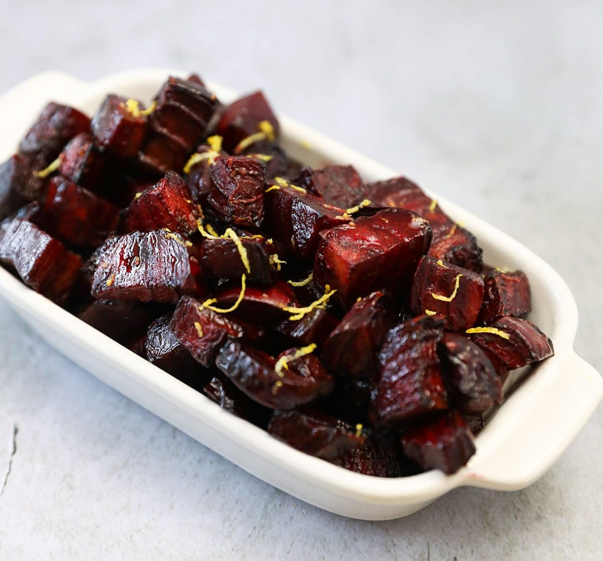 Air fryer roasted beets in a white dish on a white background