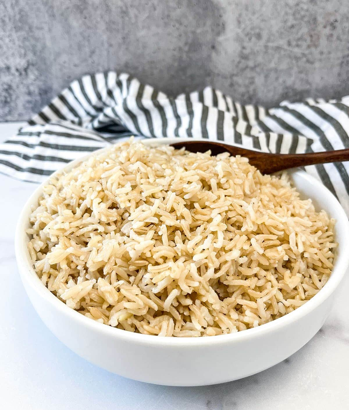 basmati rice instant pot version in a white bowl on a white background