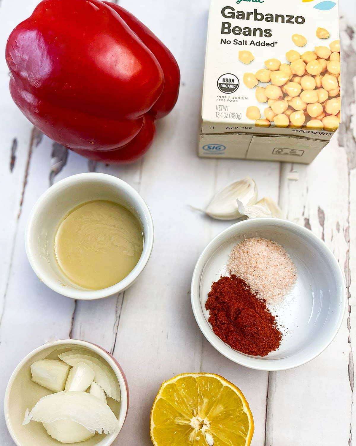 red pepper hummus ingredients on a white background