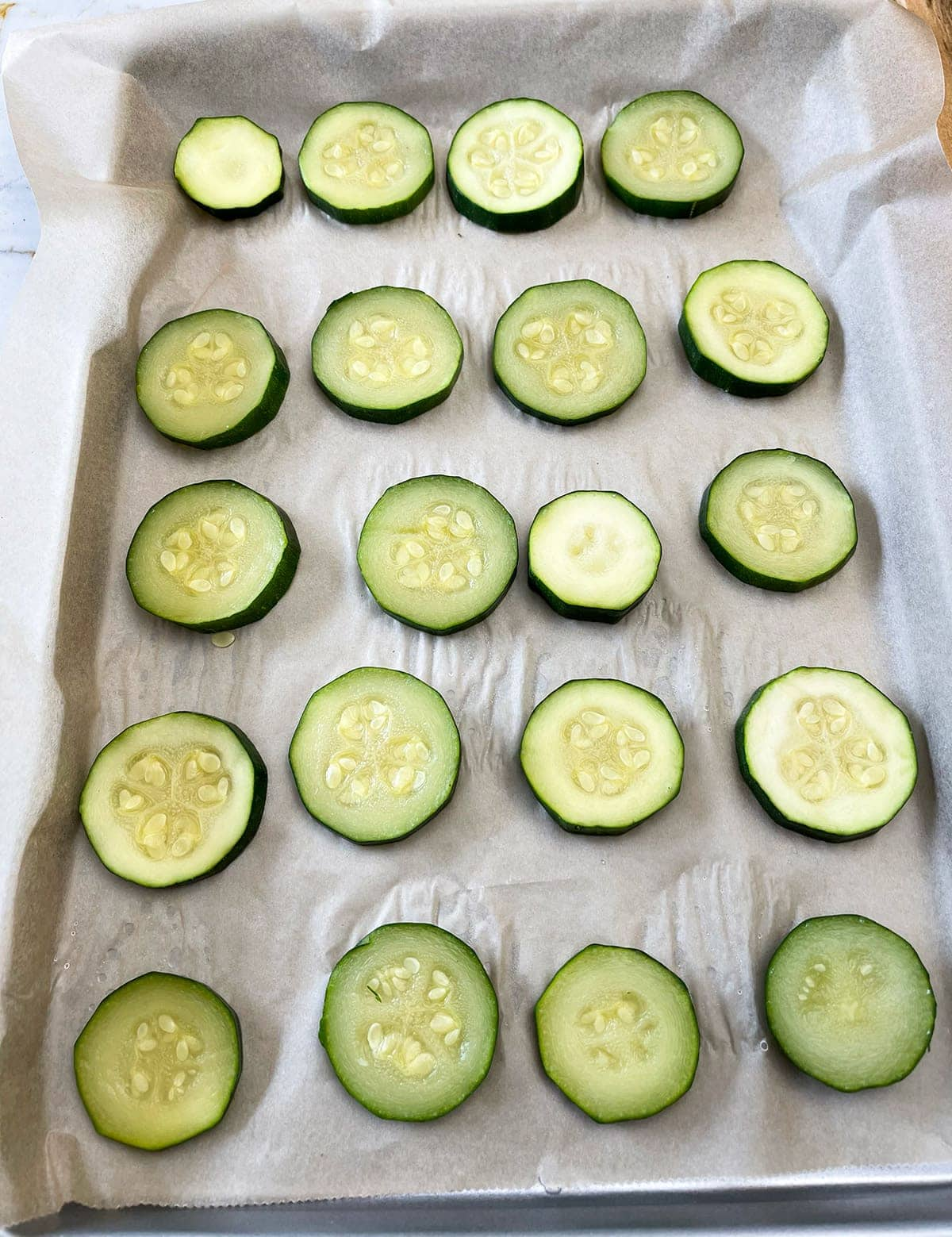 zucchini slices on a baking sheet