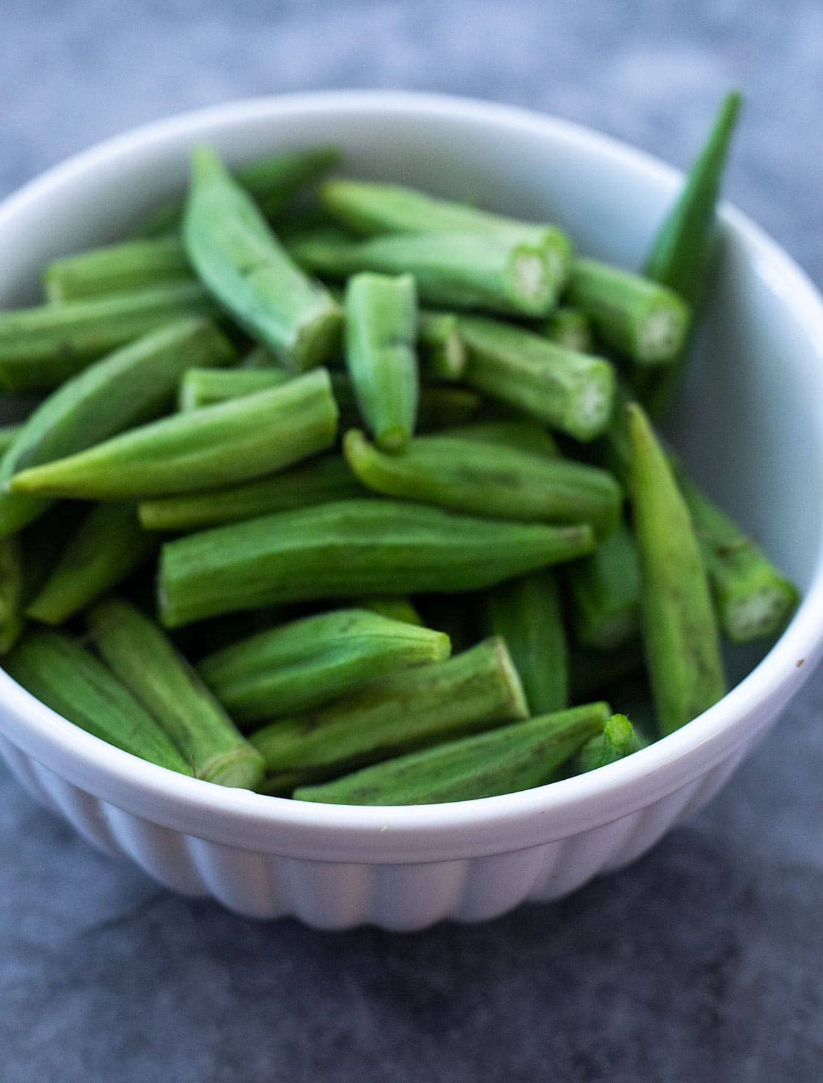 Okra in a white bowl for making okra fries