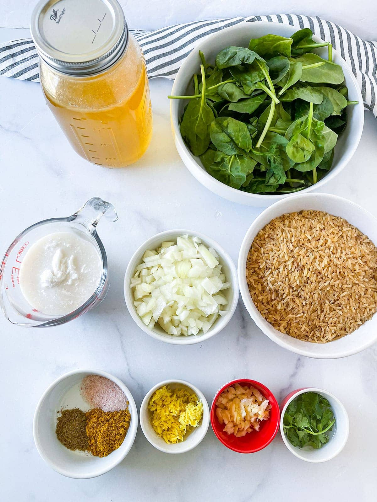 Spinach rice ingredients on a white background